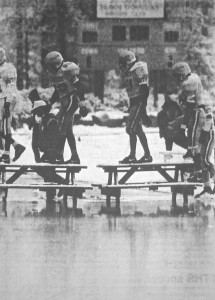 Truckee players use picnic tables to cross the field which was under more than 3 inches of water.