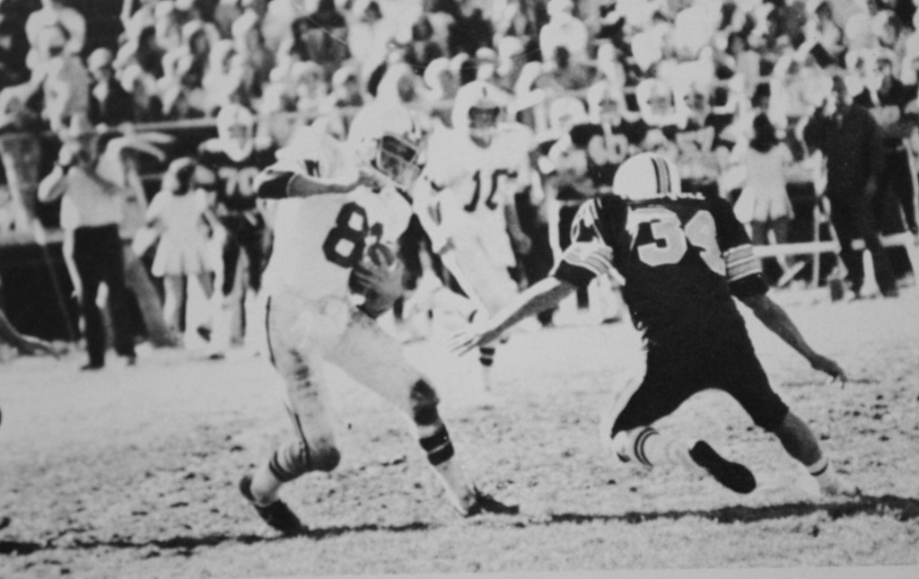 Shawn Hassell jukes Greg Velasquez (Truckee Transfer to NT) and makes good yardage after the catch at North Tahoe in 1979.