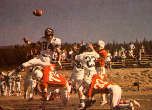 (7) John Raber gets a pass of vs Colfax, Bob Raber (32) is doing his best to protect his brother