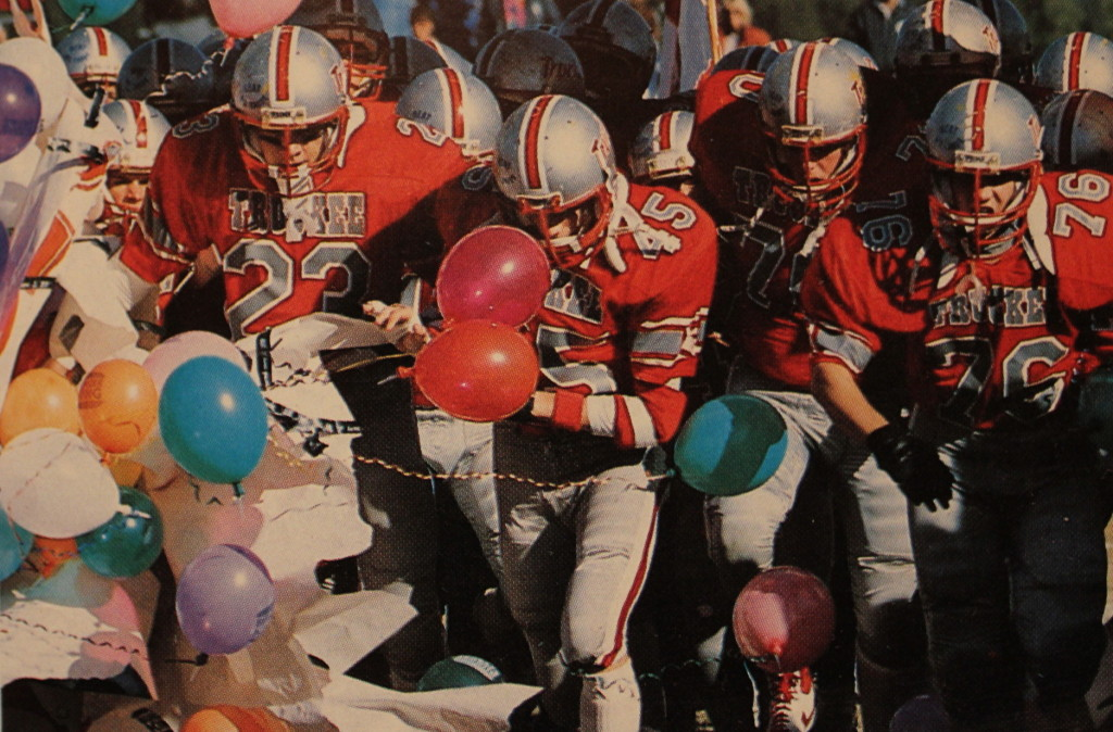 Homecoming 1986 (45) Mike Donchez leads the team out for the second half followed by (76) Brian Hadley and (23) Corey Ray