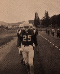 (25) Leads the team out for a home game. Quite a trek to get to the game field back in the day.