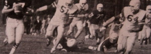 (64) Ernie Marier and (51) Wayne Kusick chase down Colfax's QB