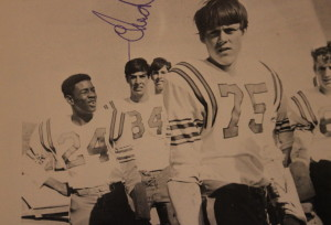 (24) Paul Miles was the first African American to play Truckee Football. Also in the photo (84) Penino, (75) Marvin Banta, and (60) Roger Anderson