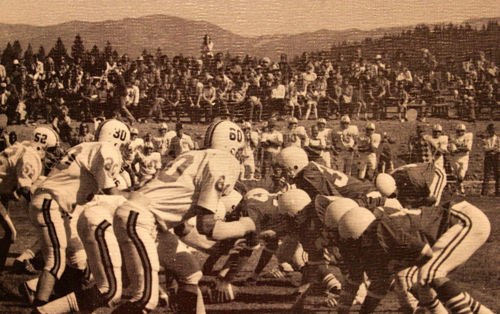 A packed house at Surprise Stadium in the first Little Big Game. A young Ken Dalton looks in from the visiting sideline right above number 60.