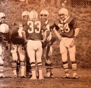(33) Rusty Tracy leads the team out of the end zone (53) Herb Copeland waits for the call.