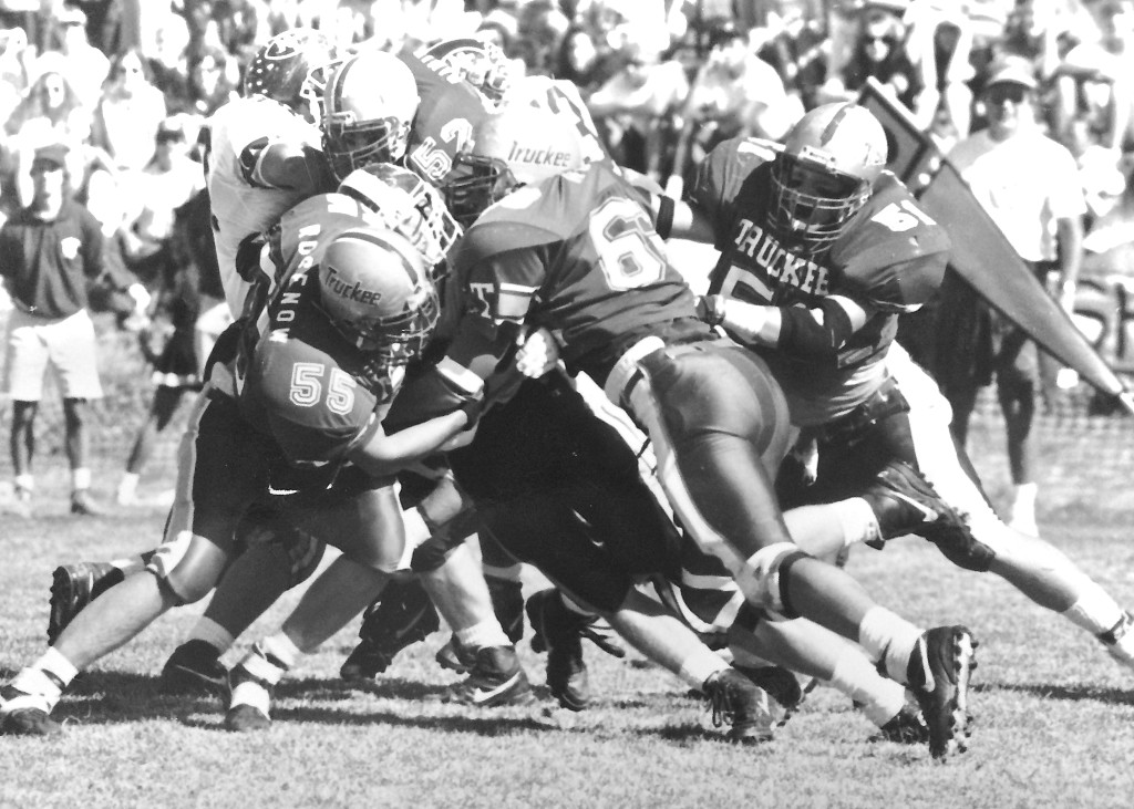 The '92 defense swarms to smother a North Tahoe ball carrier.