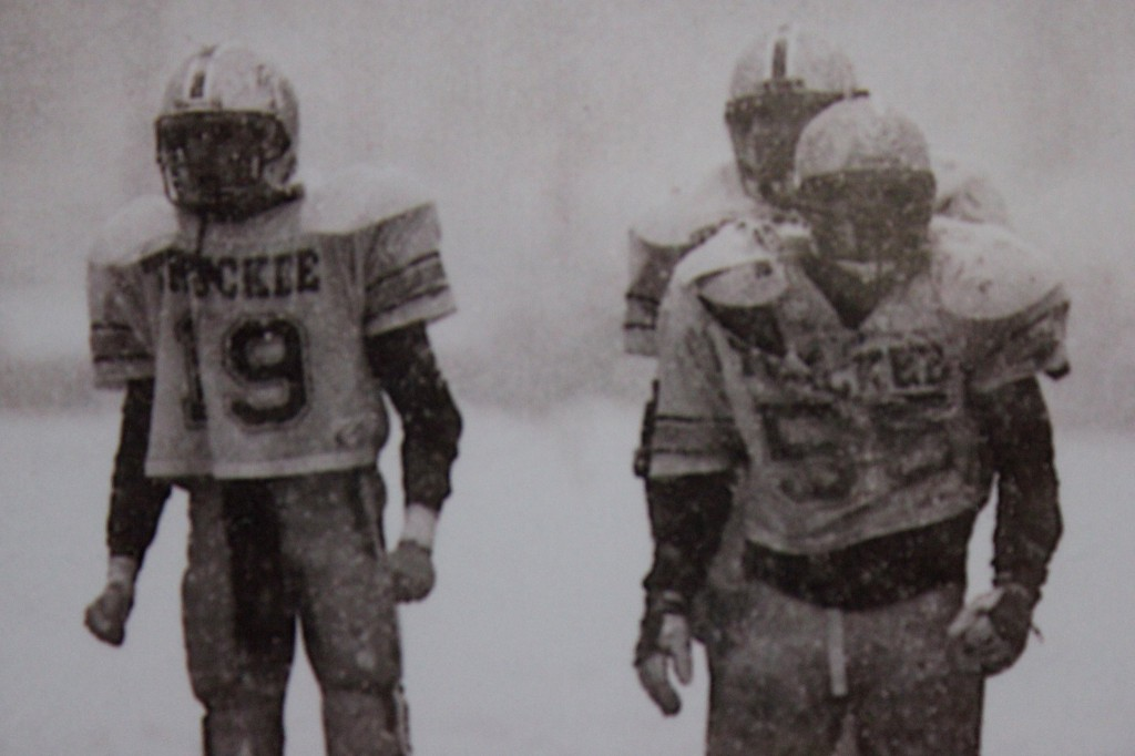 Josh Ivens and Sean Thompson await the Warriors offense to break the huddle admits a snow storm.